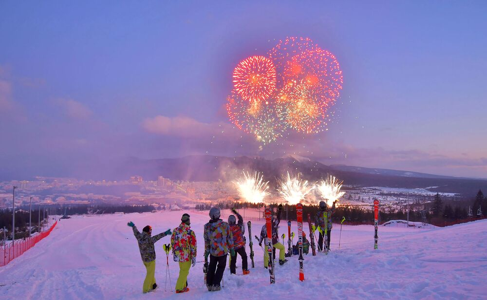 Skiers watching fireworks during a ceremony to mark the completion of the construction of the township of Samjiyon County.