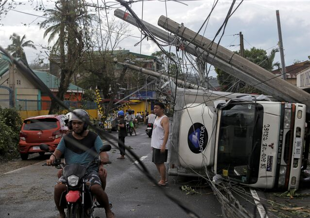 Residents are seen after Typhoon Kammuri hit Camalig town, Philippines, December 3, 2019