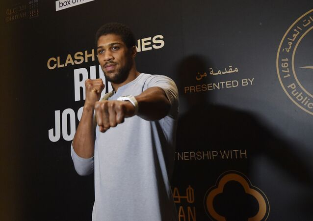 British heavyweight boxing challenger Anthony Joshua arrives for a press conference in the Saudi capital Riyadh on December 2, 2019, ahead of the upcoming Clash on the Dunes.