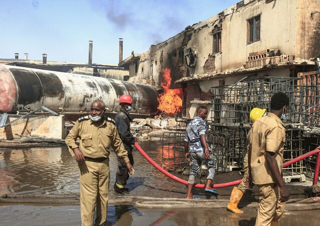 Members of the Sudanese Civil Defence put out a fire at a tile manufacturing unit in an industrial zone in north Khartoum, on December 3, 2019