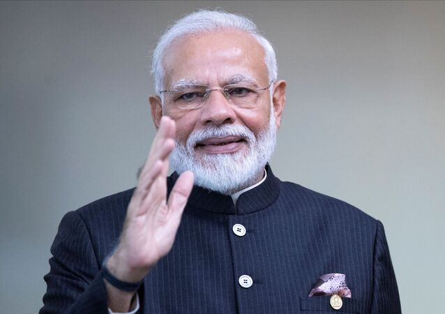 India's Prime Minister Narendra Modi greets the media prior to the BRICS summit in Brasilia, Brazil November 14, 2019