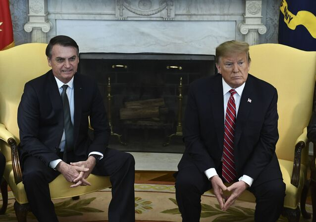 In this file photo taken on March 19, 2019 US President Donald Trump(R)and Brazilian President Jair Bolsonaro meet in the Oval Office at the White House in Washington,DC.