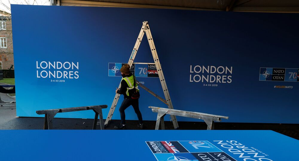 Workers prepare the 'welcome centre' prior to the NATO alliance summit, at The Grove Hotel in Watford, south-east England on 3 December 2019.