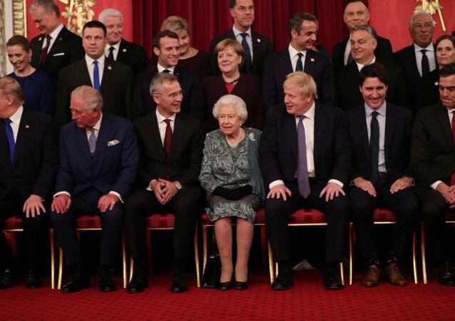 Leaders of NATO alliance countries, and its secretary general Jens Stoltenberg, join Britain's Queen Elizabeth, Prince Charles, Prime Minister Boris Johnson, U.S. President Donald Trump, German Chancellor Angela Merkel, French President Emmanuel Macron and Canadian Prime Minister Justin Trudeau for a group picture as they gather for to mark 70 years of NATO Alliance during a reception at Buckingham Palace, London, Britain December 3, 2019.