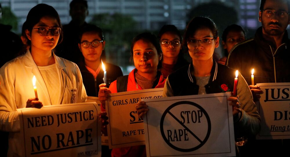 Resident doctors and medical students from All India Institute Of Medical Sciences (AIIMS) attend a candle-lit march to protest against the alleged rape and murder of a 27-year-old woman on the outskirts of Hyderabad, in New Delhi, India, 3 December 2019