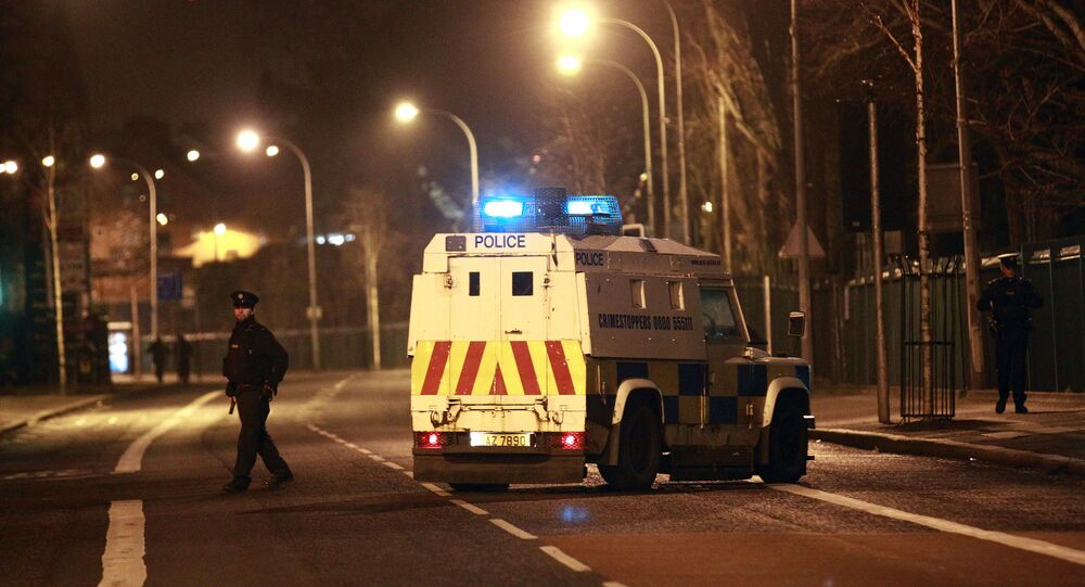 The Police Service of Northern Ireland secure the Falls road close to the scene of a bomb attack in West Belfast, Saturday, March, 15, 2014