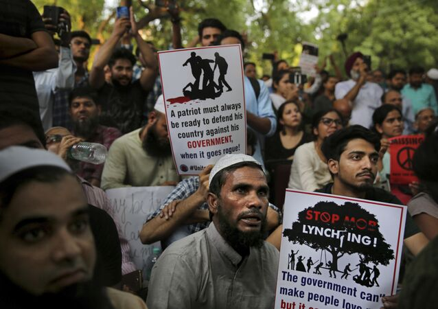 Indians hold placards condemning recent mob lynching of Muslim youth Tabrez Ansari in Jharkhand state as they listen to a speaker during a protest in New Delhi, India, Wednesday, June 26, 2019