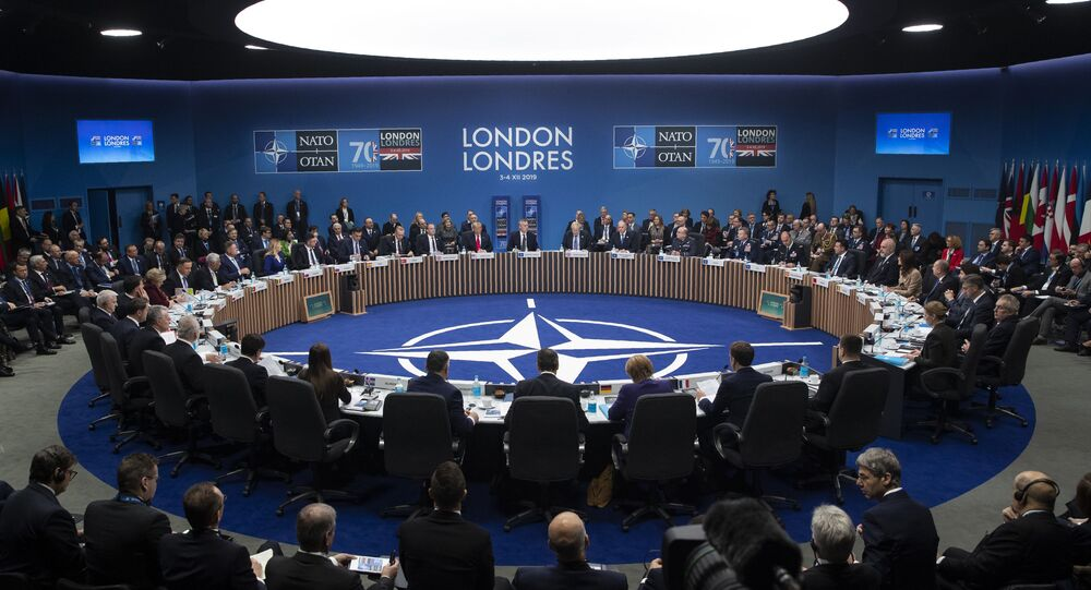 NATO Secretary General Jens Stoltenberg makes an opening statement during a plenary session at the NATO summit at The Grove,. 4 December 2019, in Watford, England
