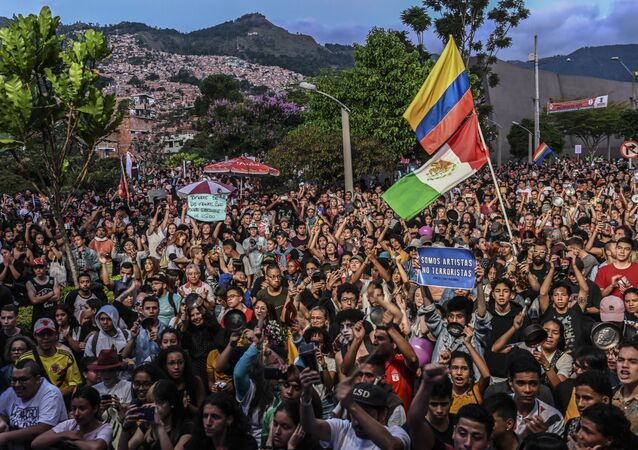 People attend a concert in support of the strike against the government of Colombian President Ivan Duque, in Medellin, Colombia on December 1, 2019,