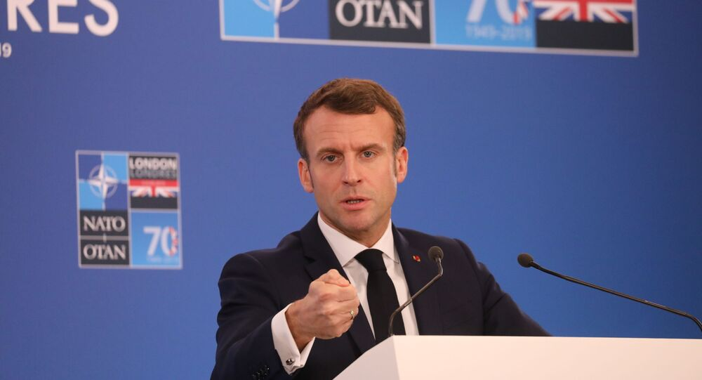 France's President Emmanuel Macron gives a press conference at the NATO summit at the Grove hotel in Watford, northeast of London on December 4, 2019.