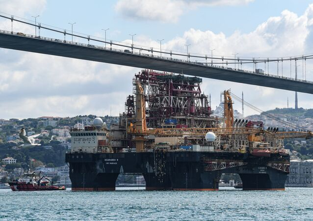 Scarabeo 9, a 115-meter-long and 78-meter-high Frigstad D90-type semi-submersible drilling rig, passes under the July 15th Martyrs Bridge (Bosphorus Bridge) on the Bosphorus Strait en route to the Black Sea in Istanbul on August 29, 2019.