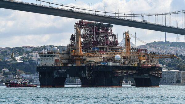 Scarabeo 9, a 115-meter-long and 78-meter-high Frigstad D90-type semi-submersible drilling rig, passes under the July 15th Martyrs Bridge (Bosphorus Bridge) on the Bosphorus Strait en route to the Black Sea in Istanbul on August 29, 2019. - Sputnik International