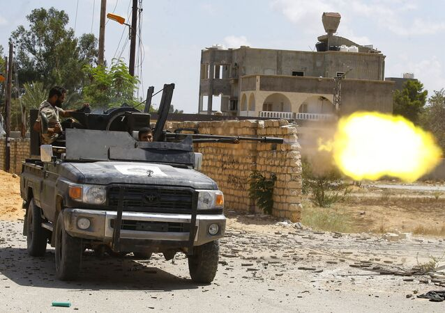 A fighter loyal to the internationally recognised Libyan Government of National Accord (GNA) fires a truck-mounted gun during clashes with forces loyal to strongman Khalifa Haftar in the capital Tripoli's suburb of Ain Zara, on September 7, 2019.