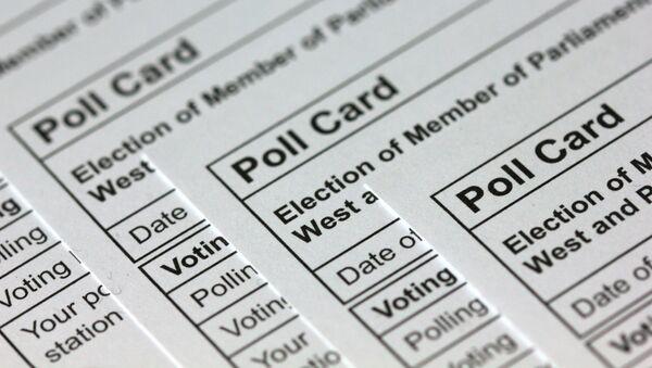 A photograph taken in London on November 14, 2019 shows polling cards for the 2019 UK general election arranged as an illustration.  - Sputnik International