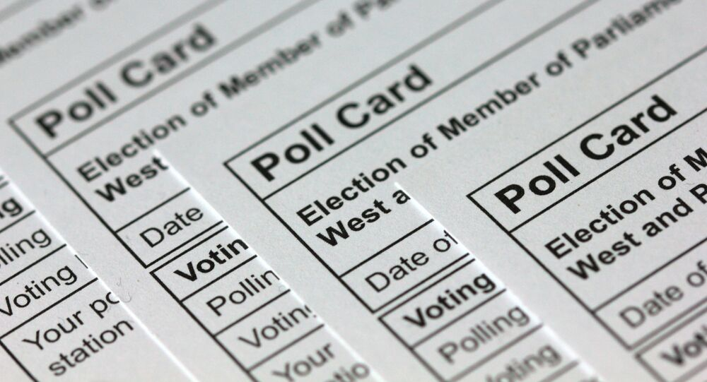 A photograph taken in London on November 14, 2019 shows polling cards for the 2019 UK general election arranged as an illustration.