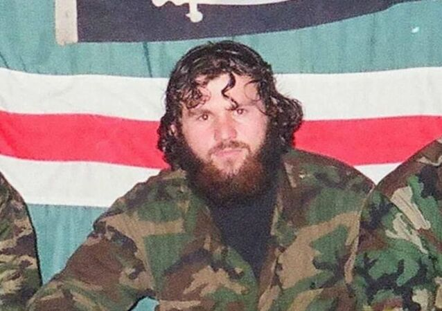 Zelimkhan Khangoshvili is pictured against the backdrop of the flag of the unrecognised Chechen Republic of Ichkeria during the Chechen conflict.