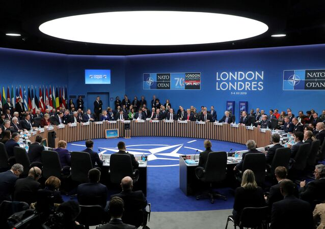 NATO heads of state attend the plenary session of the NATO summit at the Grove hotel in Watford, Britain