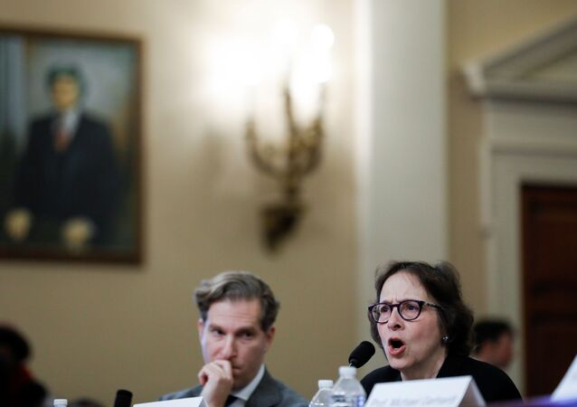 Pamela Karlan, co-director of the Supreme Court Litigation Clinic at Stanford University Law School, testifies as fellow witness Noah Feldman, a professor of law at Harvard University Law School, listens at the start of a House Judiciary Committee hearing on the impeachment inquiry