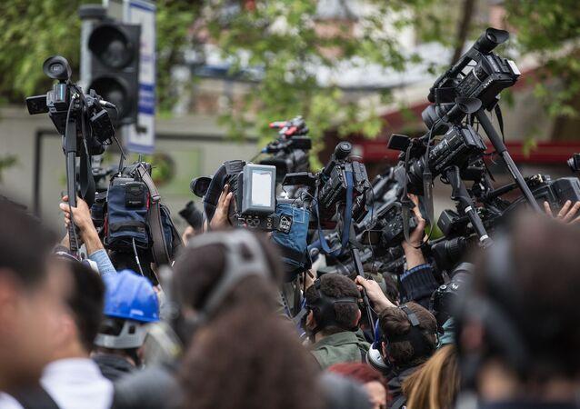 Press, cameras