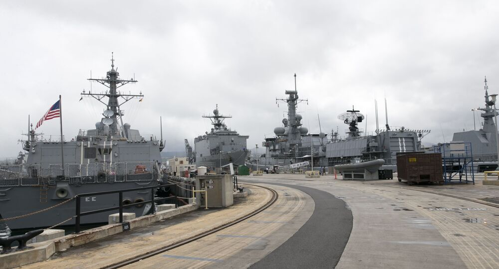 Naval ships from various countries are docked at Hawaii's Joint Base Pearl Harbor-Hickam