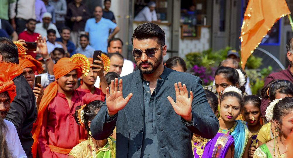 Bollywood actor Arjun Kapoor gestures as he attends the song launch of his upcoming Hindi film 'Panipat' directed by Ashutosh Gowariker in Mumbai on November 23, 2019.