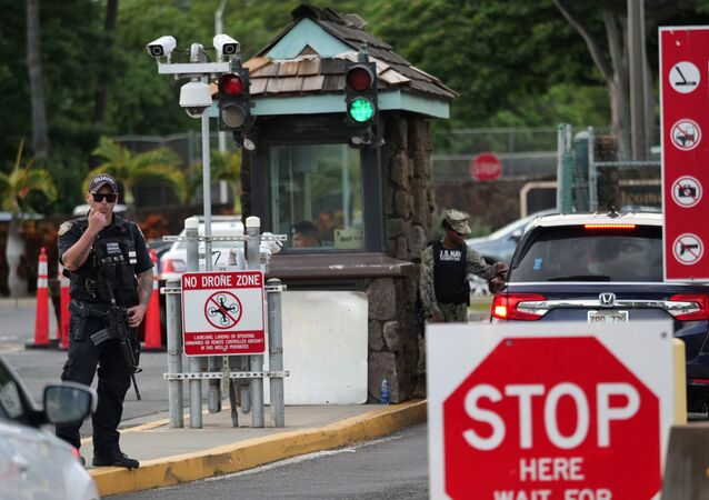A guard stands by at the Nimitz Gate of Pearl Harbor in Hawaii shortly after a sailor fatally shot two civilians at the Pearl Harbor Naval Shipyard in Honolulu, Hawaii on 4 December 2019.