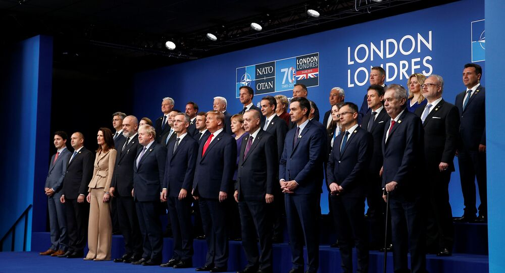 NATO Alliance leaders pose for a family photo during the annual NATO heads of government summit at the Grove Hotel in Watford, Britain December 4, 2019
