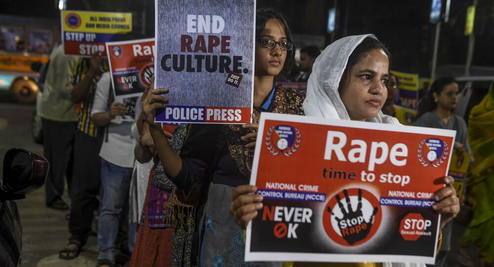 Demonstrators hold placards to protest against sexual assaults on women, following the alleged gang-rape and murder of a 27-year-old veterinarian in Hyderabad and other recent sexual assaults, during a march in Kolkata on December 4, 2019