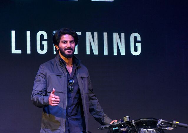 Bollywood actor and promoter of the startup Ultraviolette Automotive Private Limited, Dulquer Salmaan poses for a photograph during the unveiling of F77, India's first high performance electric motorcycle designed and developed by the company, in Bangalore on November 13, 2019