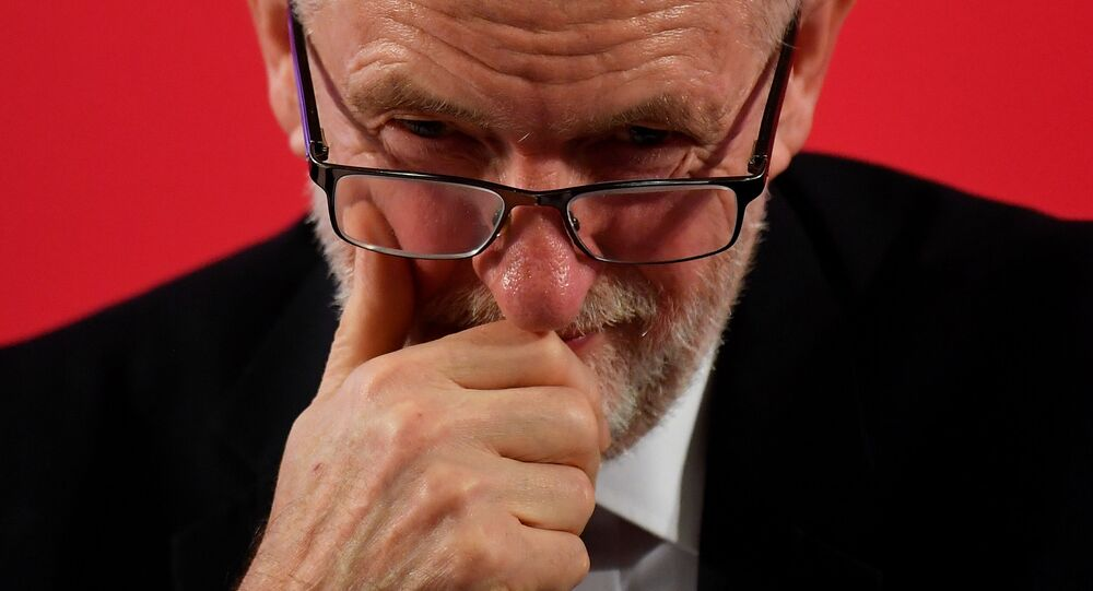 Britain's opposition Labour Party leader Jeremy Corbyn looks on during a general election campaign event in London, Britain November 27, 2019