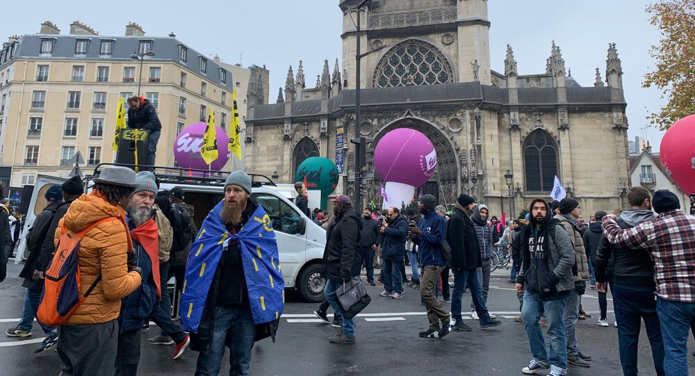 Protesters during a demonstration against French government's pensions reform plans in Paris as part of a day of national strike and protests in France, December 5, 2019