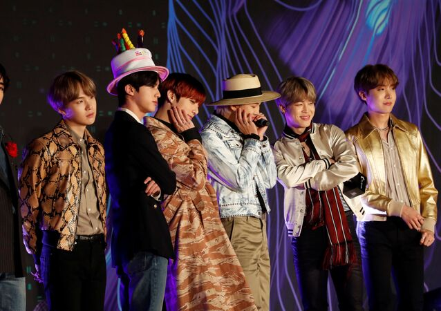 Members of South Korean boy band BTS pose on the red carpet during the annual MAMA Awards at Nagoya Dome