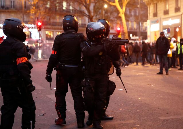 French CRS riot police secure an area during clashes at a demonstration against French government's pensions reform plans in Paris as part of a day of national strike and protests in France, December 5, 2019.