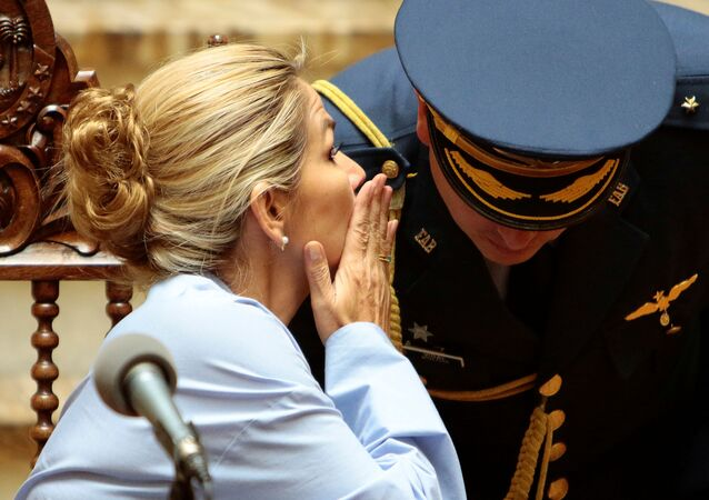 Bolivia's interim President Jeanine Anez talks to a military officer during a ceremony at the presidential palace in La Paz, Bolivia, November 29, 2019.