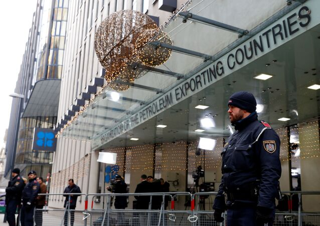 Journalists and police officers stand outside the Organisation of the Petroleum Exporting Countries (OPEC) headquarters in Vienna, Austria December 5, 2019