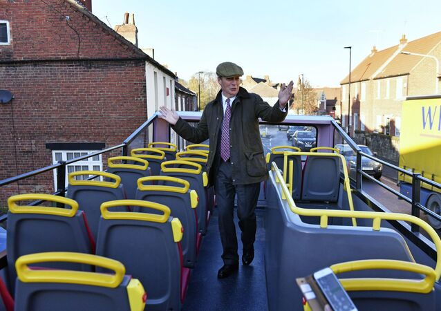 Brexit Party leader Nigel Farage on the party's campaign bus while on the General Election campaign trail in Worksop, England, Tuesday, 3 December 2019