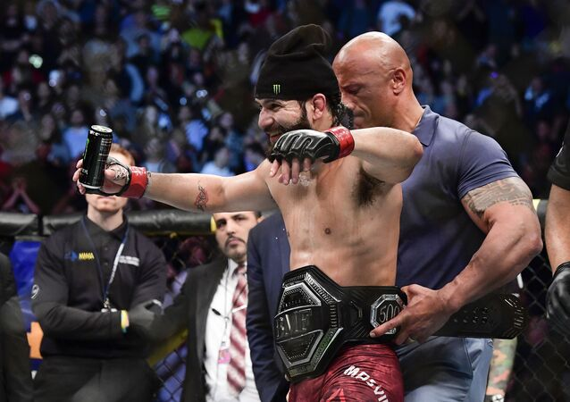 Jorge Masvidal of the United States is awarded the belt by Dwayne the Rock Johnson after his victory by TKO on a medical stoppage against Nate Diaz of the United States in the Welterweight BMF championship bout during UFC 244 at Madison Square Garden on November 02, 2019 in New York City