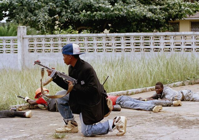 Rebels loyal to Charles Taylor fire at government troops near Monrovia, Liberia in August 1990