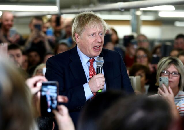 Britain's Prime Minister Boris Johnson delivers a speech to workers during a Conservative Party general election campaign visit to John Smedley Mill in Matlock, central England, on 5 December 2019.