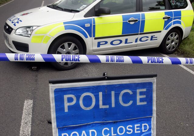 Police close off a road near Chertsey in Surrey, southern England