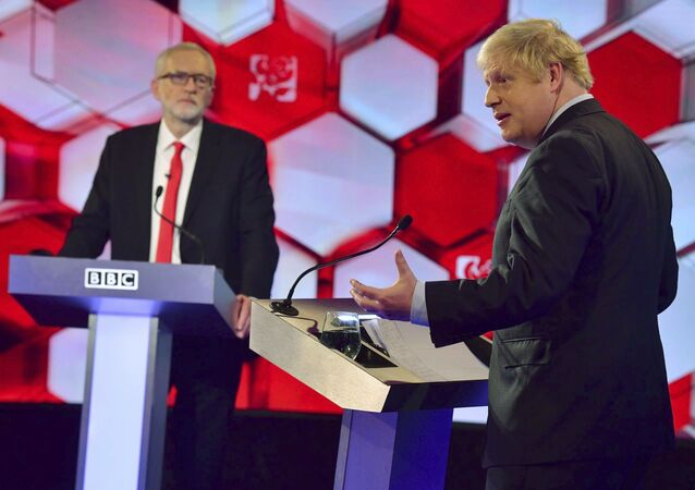 Opposition Labour Party leader Jeremy Corbyn, left, and Britain's Prime Minister Boris Johnson, during a head to head live Election Debate at the BBC TV studios