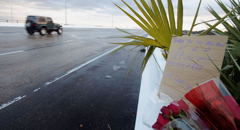 Flowers and a message are left on the entrance bridge after a member of the Saudi Air Force visiting the United States for military training was the suspect in a shooting at Naval Air Station Pensacola, in Pensacola, Florida, U.S. December 6, 2019.