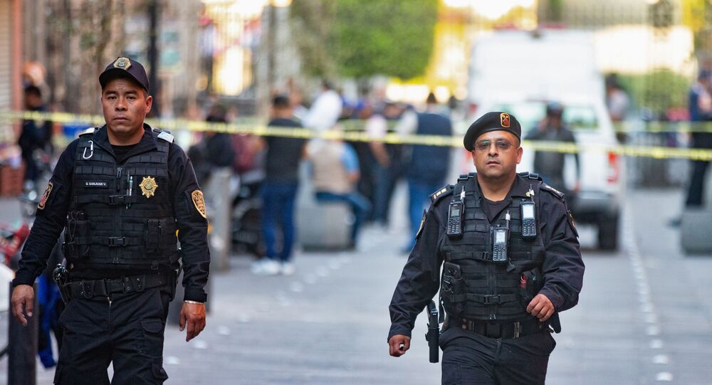 Police officers guard a crime scene where four people were killed and two injured in a shooting near Mexico's National Palace, the presidential residence in the capital's historic downtown, officials said, in Mexico City, Mexico December 7, 2019.