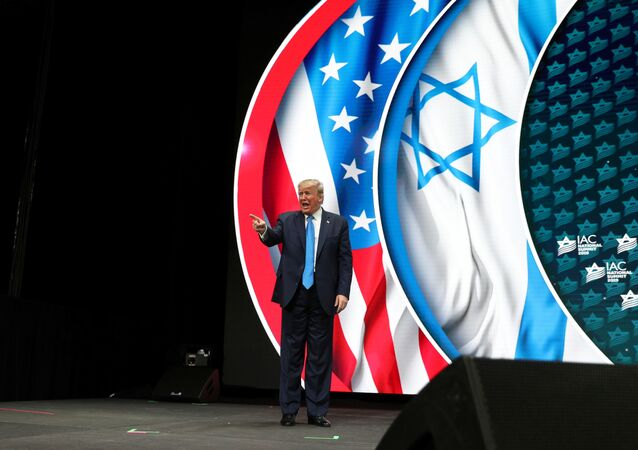 U.S. President Donald Trump bids farewell to the audience after delivering remarks at the Israeli American Council National Summit in Hollywood, Florida, U.S., December 7, 2019.
