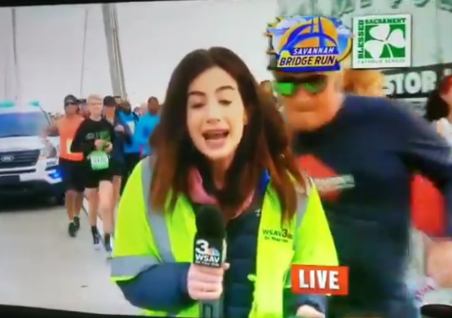 Screenshot of Georgia NBC News affiliate (WSAV) reporter groped on live television by participant in running event in Savannah, Georgia, United States - 07.12.2019