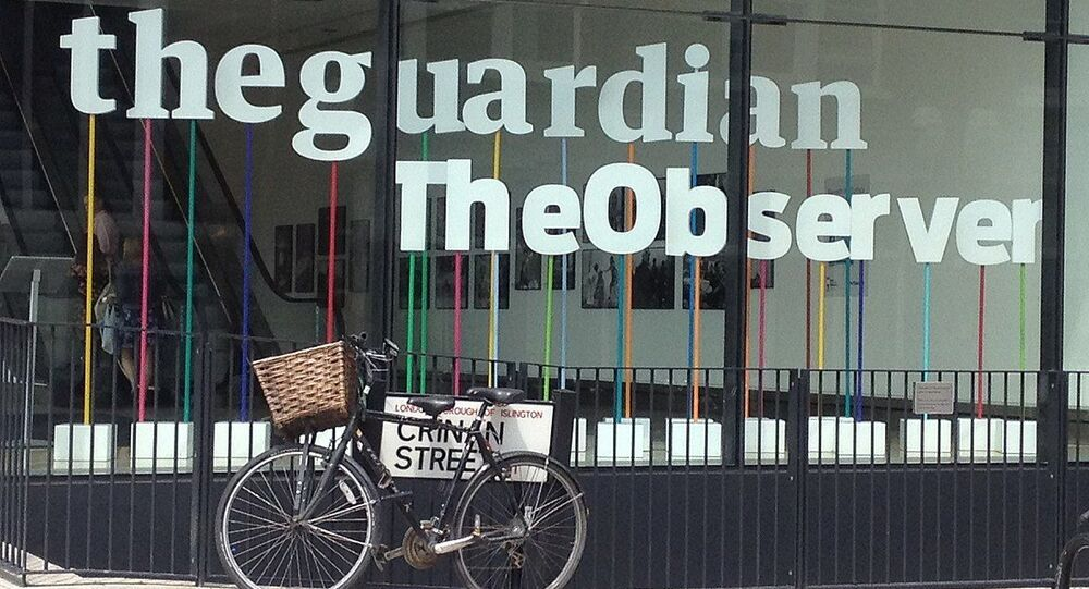 Window of the building housing The Guardian newspaper, London England