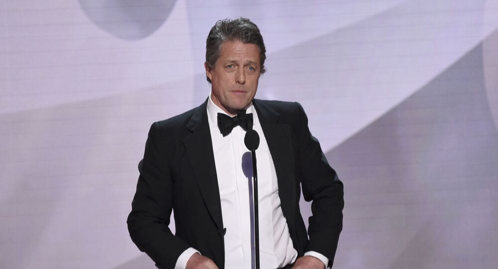 Hugh Grant presents the award for outstanding performance by an ensemble in a drama series at the 25th annual Screen Actors Guild Awards