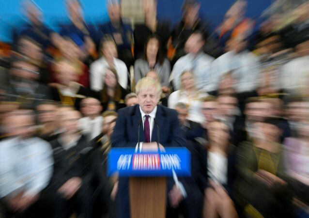 Britain's Prime Minister Boris Johnson speaks to the workers as he visits a JCB factory during his general election campaign in Uttoxeter, Britain, December 10, 2019. Picture taken with a zoom burst. REUTERS/Toby Melville