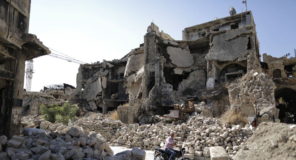 A man in the rubble of the old city of Aleppo