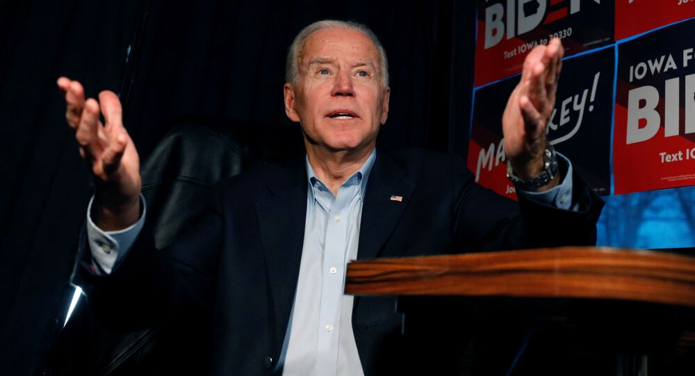 Democratic 2020 U.S. presidential candidate and former U.S. Vice President Joe Biden answers a question on  Biden's No Malarkey! campaign bus before an event in Elkader, Iowa, U.S., December 6, 2019